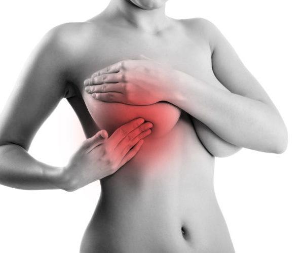 Почему перед месячными набухает и начинает болеть грудь, нормально ли это и что с этим делать?