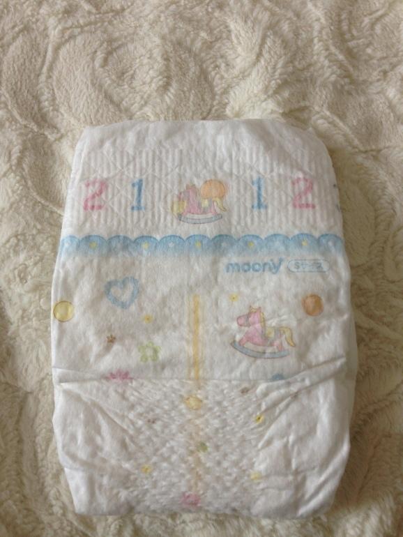 Рейтинг лучших японских подгузников для новорожденных детей: merries, moony и goon